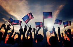 Group of People Waving Armenian Flags in Back Lit Stock Photos
