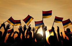 Group of People Waving Armenian Flags in Back Lit Royalty Free Stock Photo