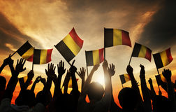 Group of People Waving Belgian Flags in Back Lit Stock Photos