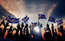 Group of People Waving Icelandic Flags Royalty Free Stock Images