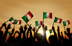 Group of People Waving Italian Flags in Back Lit Stock Images