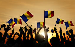 Group of People Waving Romanian Flags in Back Lit Royalty Free Stock Photography