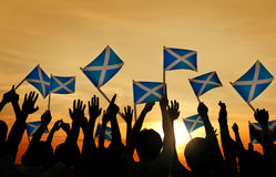 Group of People Waving Scottish Flags Royalty Free Stock Photos