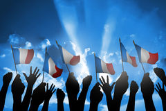 Group of people waving small france flag Stock Images