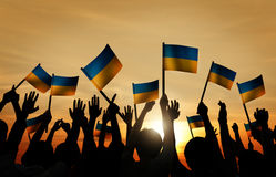 Group of People Waving Ukrainian Flags in Back Lit Royalty Free Stock Photography