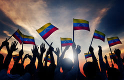 Group of People Waving Venezuelan Flags in Back Lit Stock Photography