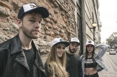 Group of People Wearing Fitted Caps Beside Road Royalty Free Stock Image
