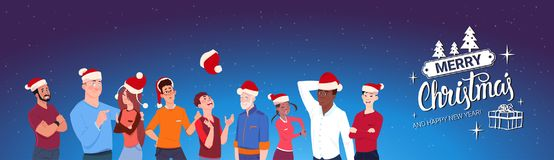 Group Of People Wearing Santa Hats Merry Christmas And Happy New Year Banner Royalty Free Stock Image