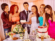 Group people at wedding singing song. Happy group people at wedding taking cake. Table with a lot of food stock image