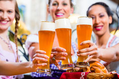Group of people with wheat beer in Bavarian pub Royalty Free Stock Image