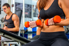 Group of people  working with dumbbells  at gym Royalty Free Stock Photo