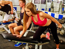 Group of people working with dumbbells at gym. Stock Photos