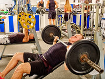 Group of people  working with dumbbells  at gym Royalty Free Stock Images