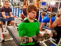 Group of people working with dumbbells at gym. Stock Photography