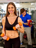 Group of people working with dumbbells at gym. Stock Image