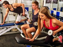 Group of people working with dumbbells at gym. Royalty Free Stock Photography