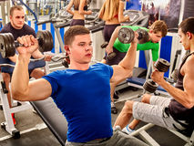 Group people working his arms and chest at gym Stock Images