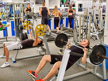 Group of people working his body at gym. Stock Photo