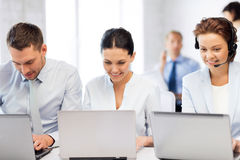 Group of people working with laptops in office Stock Image
