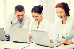 Group of people working with laptops in office. Picture of group of people working with laptops in office royalty free stock photos