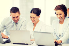 Group of people working with laptops in office. Picture of group of people working with laptops in office stock image
