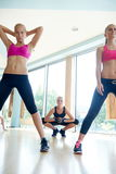Group of  people working out in a fitness gym Royalty Free Stock Images