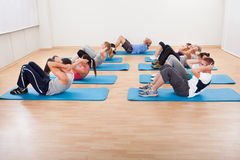 Group of people working out in a gym Stock Photography