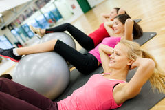 Group of people working out in pilates class Royalty Free Stock Images