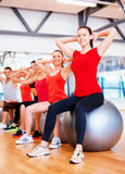 Group of people working out in pilates class Royalty Free Stock Photography
