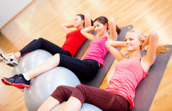 Group of people working out in pilates class Stock Image