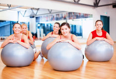 Group of people working out in pilates class Stock Photo