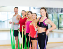 Group of people working out with rubber bands Stock Photos