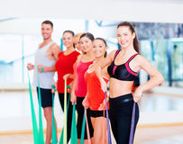 Group of people working out with rubber bands Stock Images