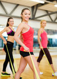 Group of people working out with rubber bands Royalty Free Stock Photography