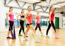 Group of people working out with rubber bands Royalty Free Stock Image