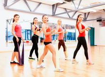 Group of people working out with rubber bands Royalty Free Stock Photos