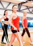 Group of people working out with rubber bands Royalty Free Stock Images