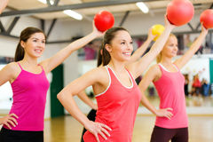 Group of people working out with stability balls Royalty Free Stock Image