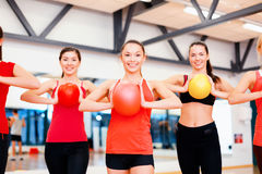 Group of people working out with stability balls Stock Image