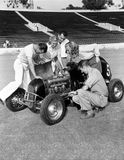 Group of people working on racecar Stock Images