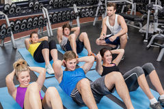 Group of people working their abs Royalty Free Stock Image