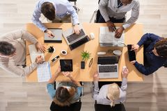 Group Of People Working At Workplace royalty free stock photo