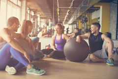 Group of people workout in healthy club. People having conversation after Pilates exercise with Pilates ball Stock Photography