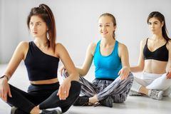A group of people from yoga is engaged in training in the gym. The concept of sports, healthy lifestyle, fitness, stretching.  stock photo
