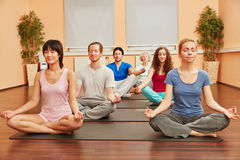 Group of people during yoga meditation class. Group of people during yoga meditation breathing exercise class Royalty Free Stock Images