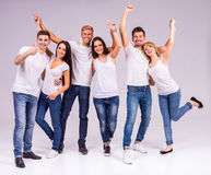 Group of people. A group of young people smiling on a gray background. Studio shooting Royalty Free Stock Images