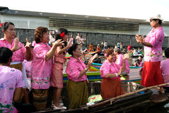 Group of peoples dancing into the boat on Rub Bua Festival. Stock Photo