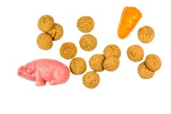 Group of Pepernoten cookies and marzipan pig and carrot Royalty Free Stock Photos