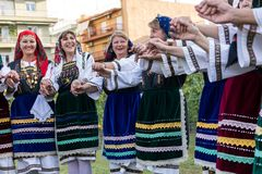 Group performing Greek folklore dance. Thessaloniki, Greece - Sept  21, 2017: Group performing Greek folklore dance during the harvest season Royalty Free Stock Photography