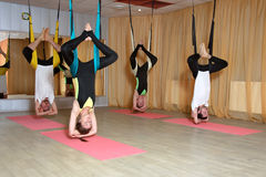 Group performs a fly-yoga exercises stock photo